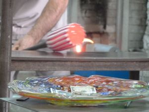 A glass vase being made