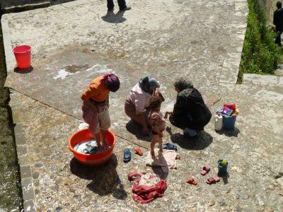 Washing rugs in the sun