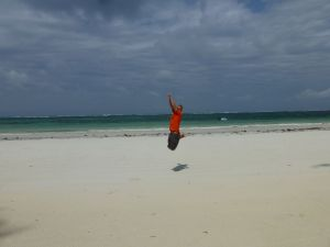 Jumping on the deserted beach