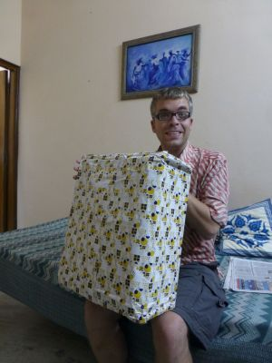 Reuben unwrapping our gift wrapped computer