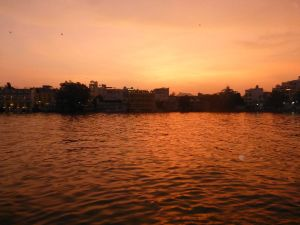 The sun setting over Lake Pichola