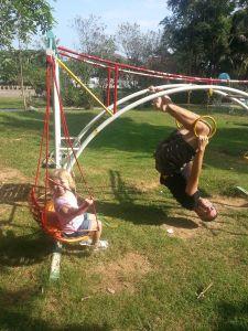 Olivia and Reuben swinging