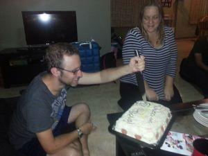 Doug cuts cake